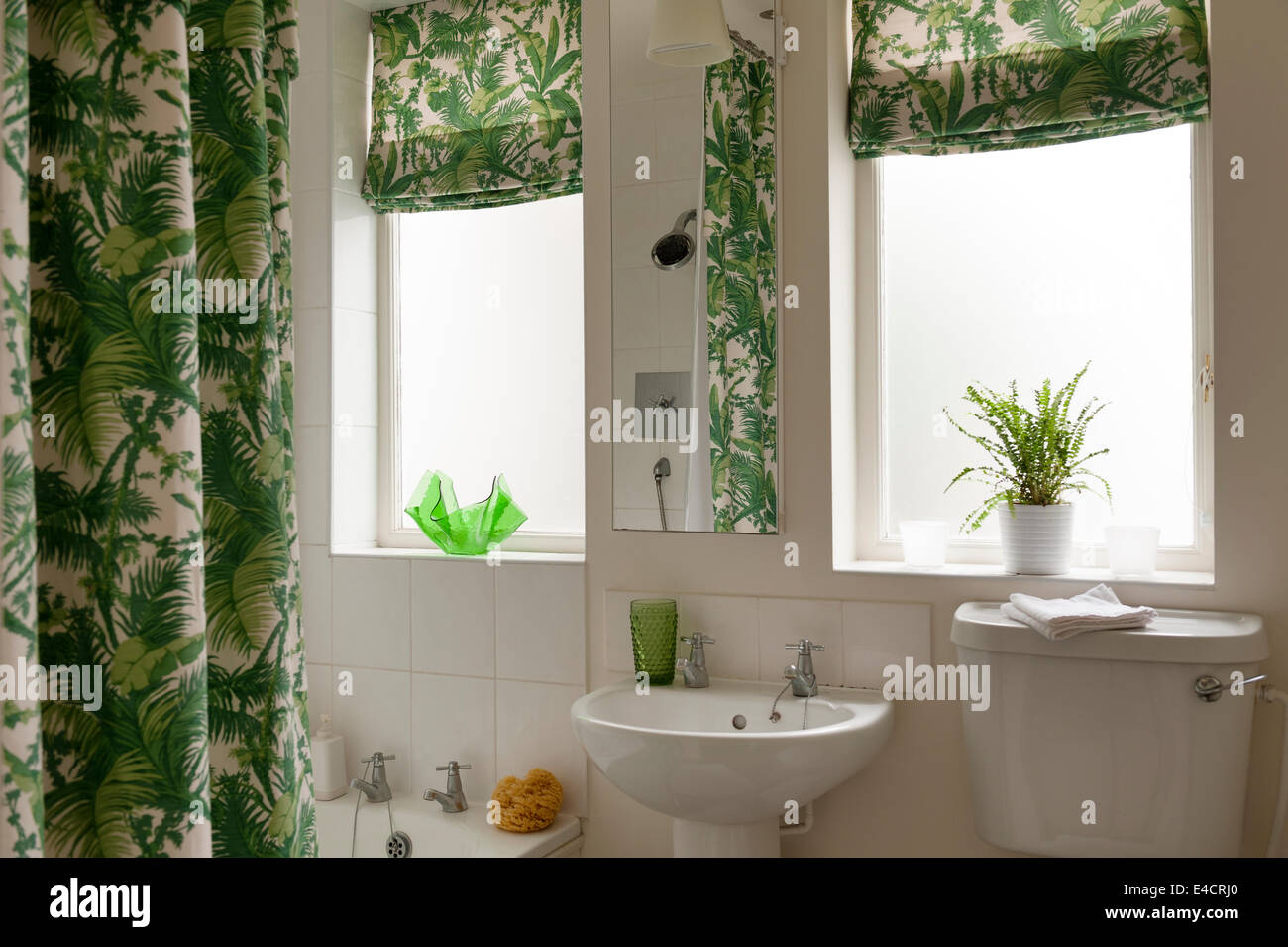 Bathroom with Waikiki by Bennison shower curtain and blinds - Stock Image