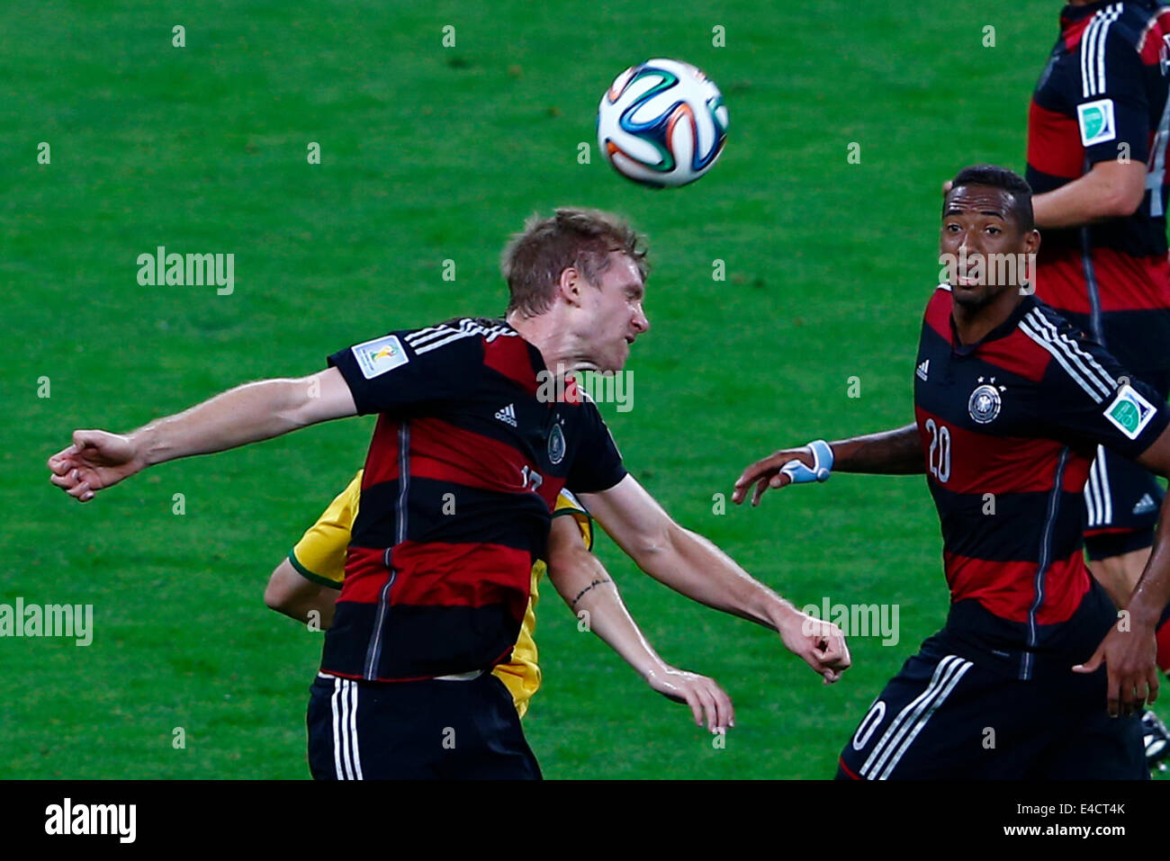 Belo Horizonte, Brazil. 8th July, 2014. Germany's Per Mertesacker (front, L) heads the ball during a semifinal match Stock Photo
