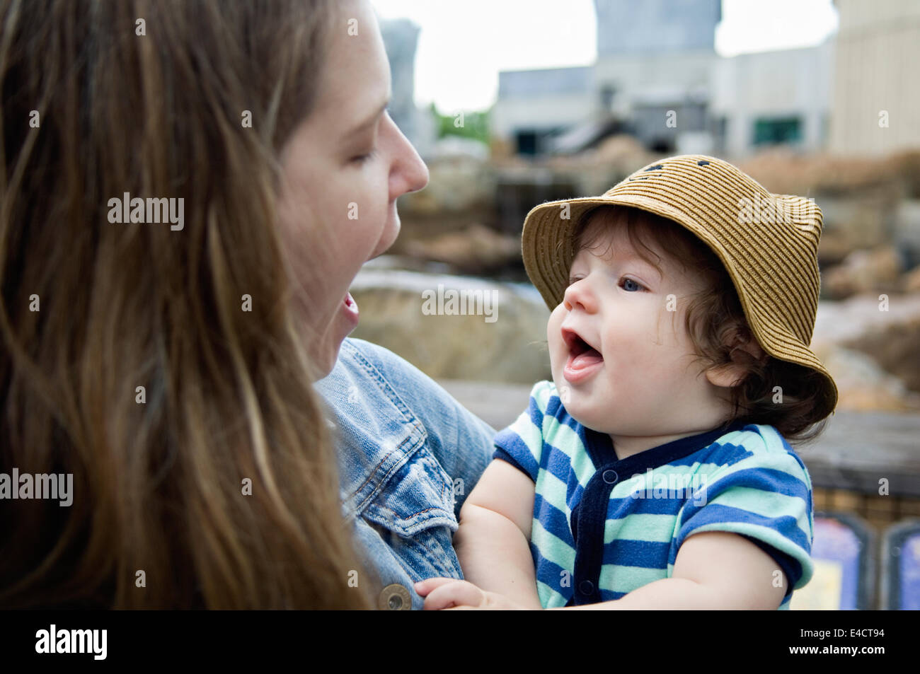 Six Month Old Baby Boy Interacting with His Mom - Stock Image