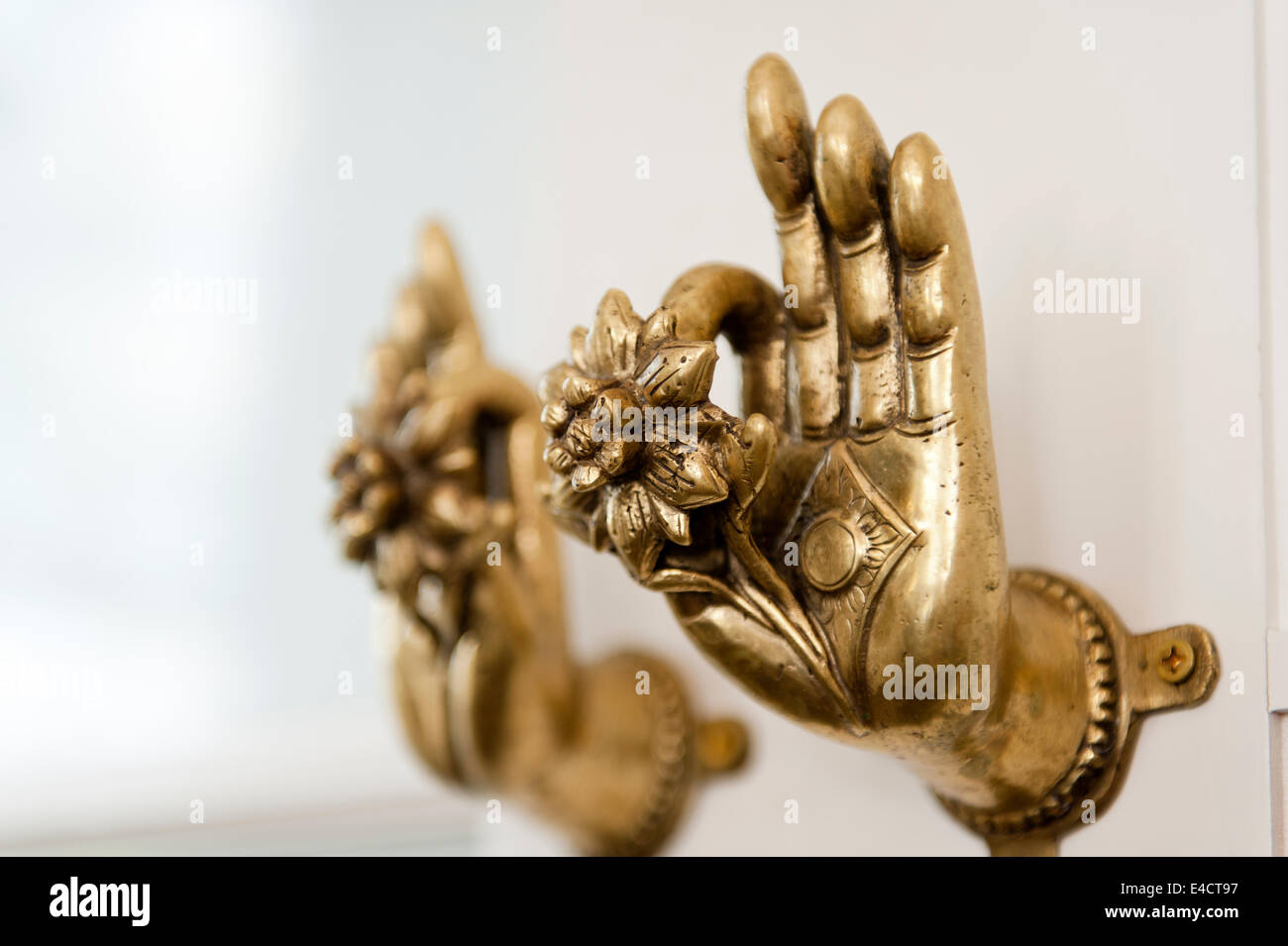 Door knobs in the shape of hands holding lotus flowers brought back ...