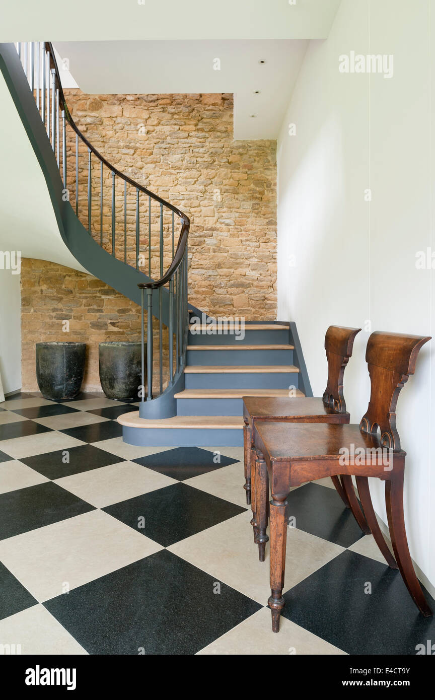 Pair Of Willaim IV Mahogany Hall Chairs In Hallway With Large Checked  Flooring And Swirling Staircase