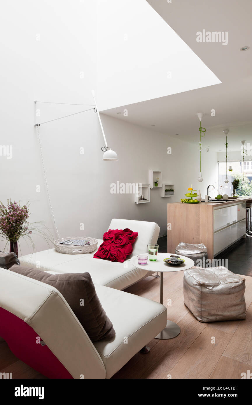 White modular Edra sofas in open plan kitchen living space. The Kitchen is by Beeck and the red cushion from John - Stock Image