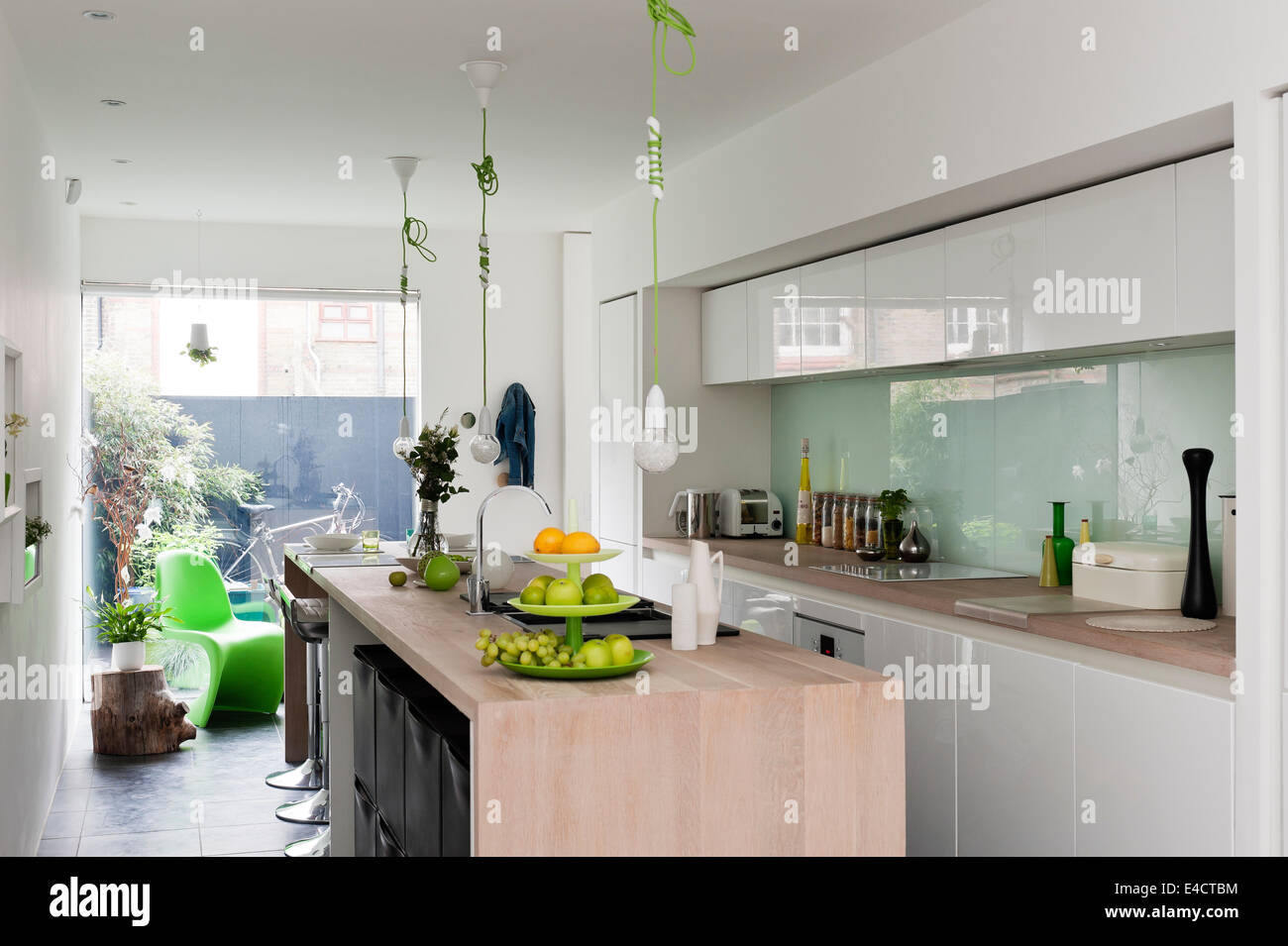 Modern kitchen from beeck kuechen the green corded pendant lights the green corded pendant lights are by nud and the green s chair by verner panton aloadofball Choice Image