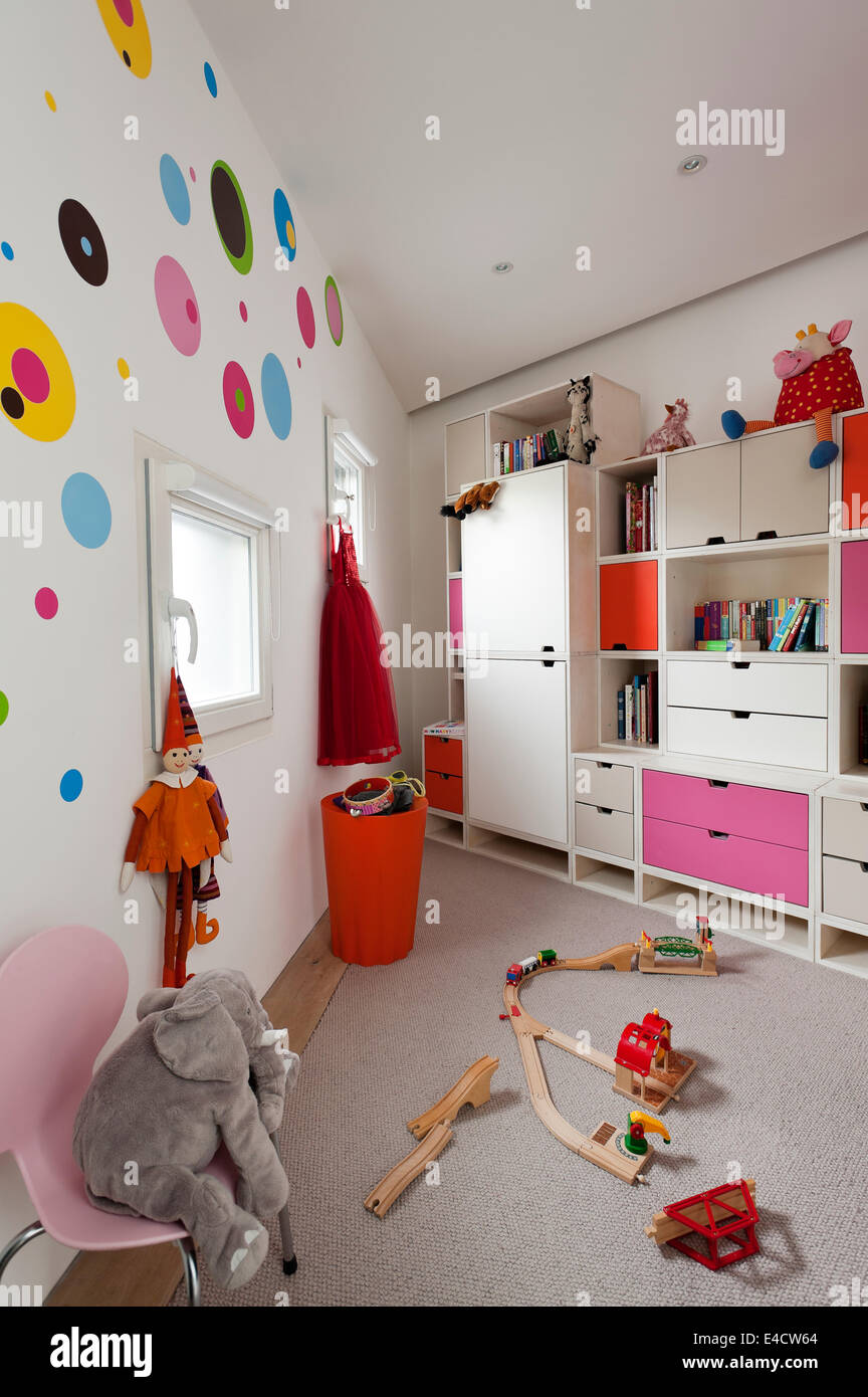Modular storage unit in kids bedroom with assorted toys and an Arne Jacobsen Series 7 chair & Childrens Bedroom Storage Stock Photos u0026 Childrens Bedroom Storage ...