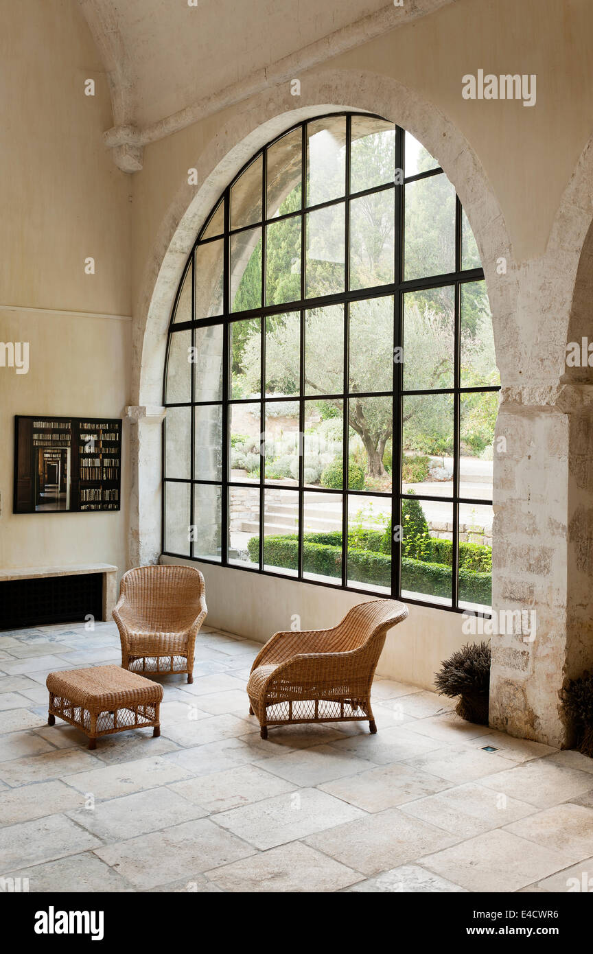 Stone Floored Gallery Style Space With Large Arched Window