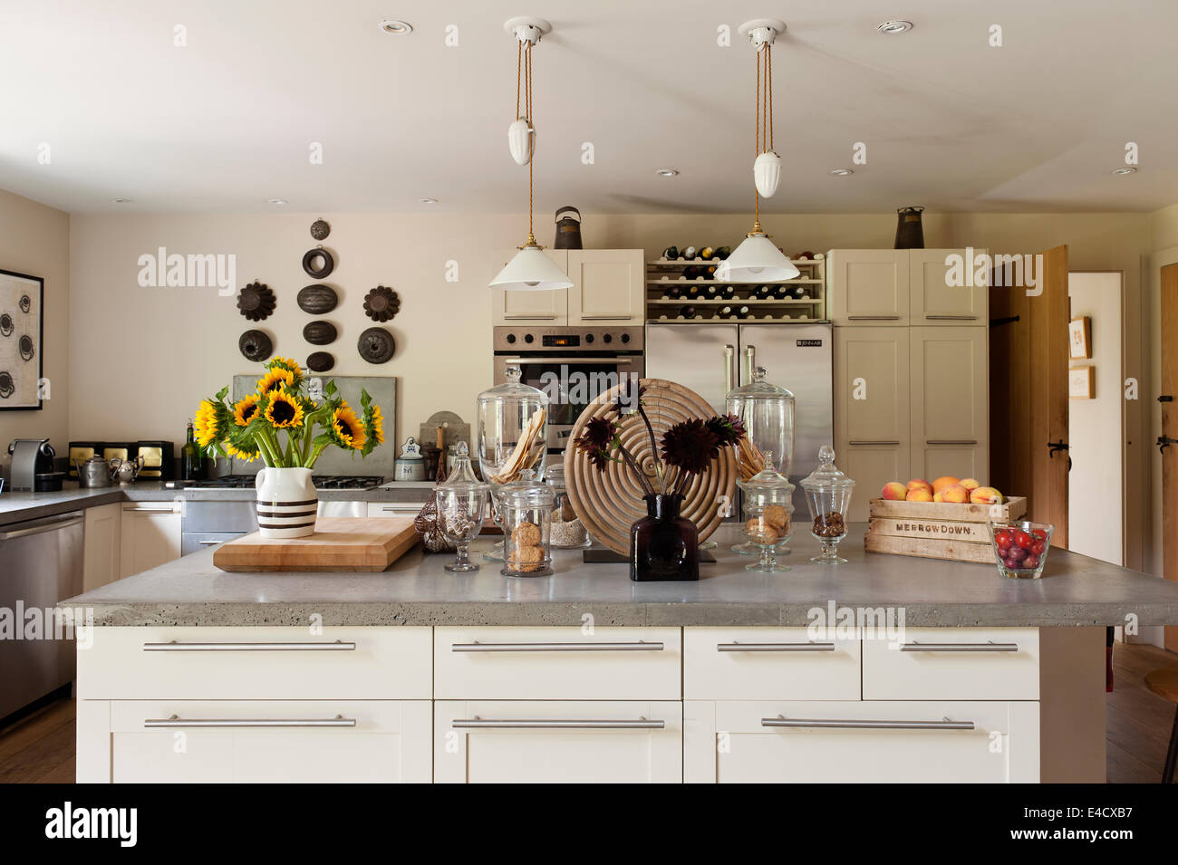 Concrete worktops in a kitchen with french pendant lights stock concrete worktops in a kitchen with french pendant lights aloadofball Gallery