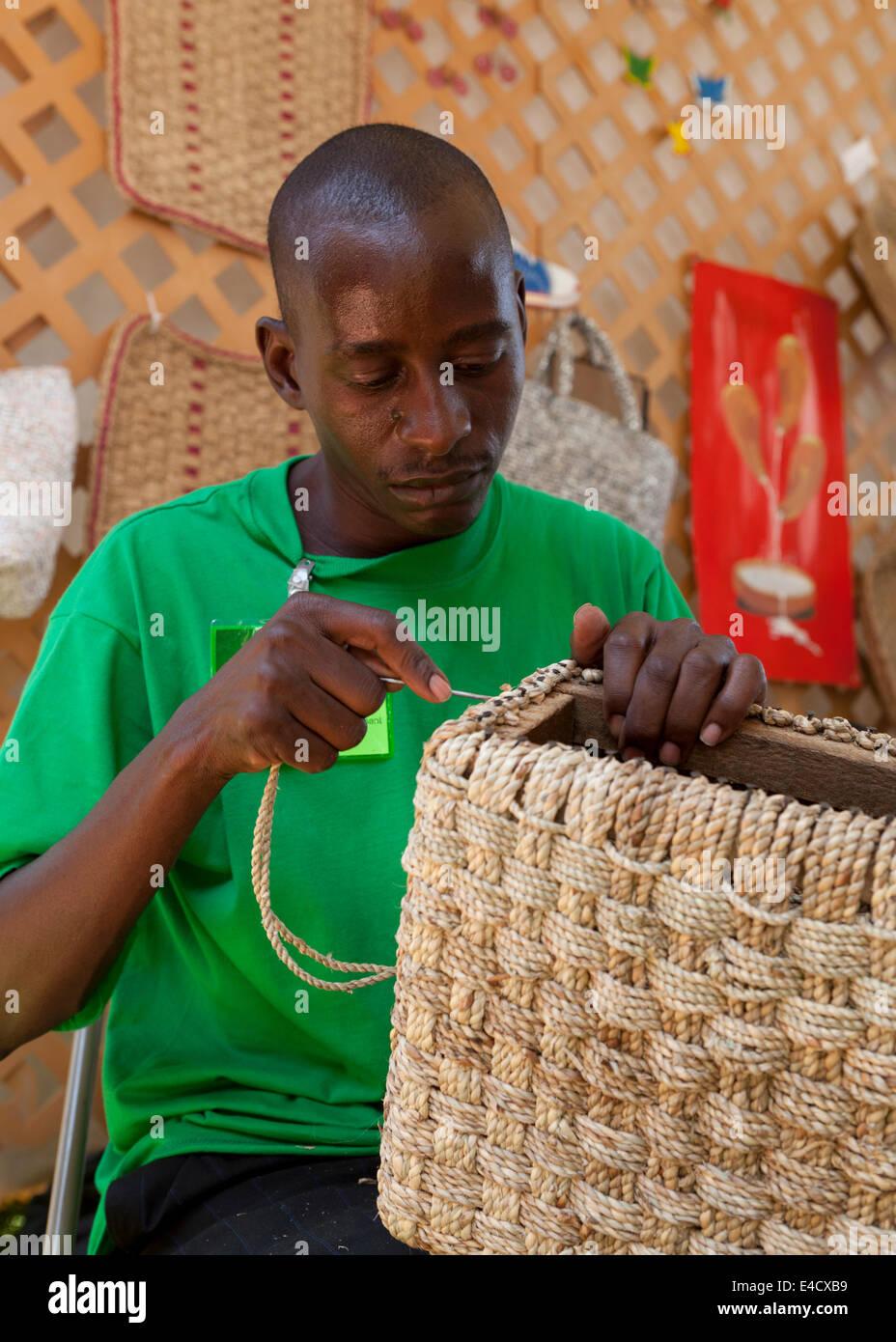 Kenyan man weaving basket - USA Stock Photo