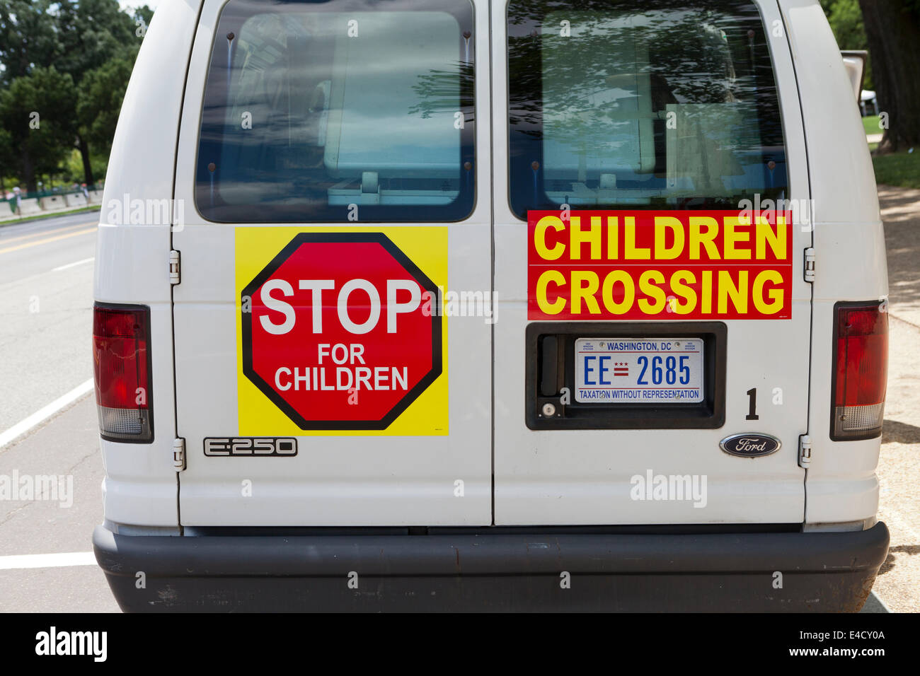 Children crossing warning signs on back of ice cream truck ...
