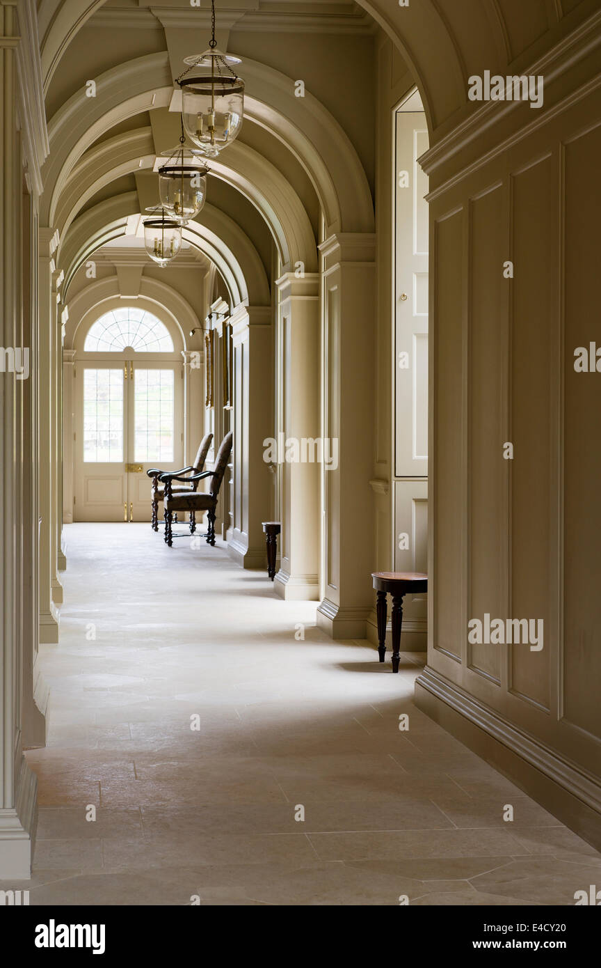 Arched corridor with sandstone flagged floor - Stock Image