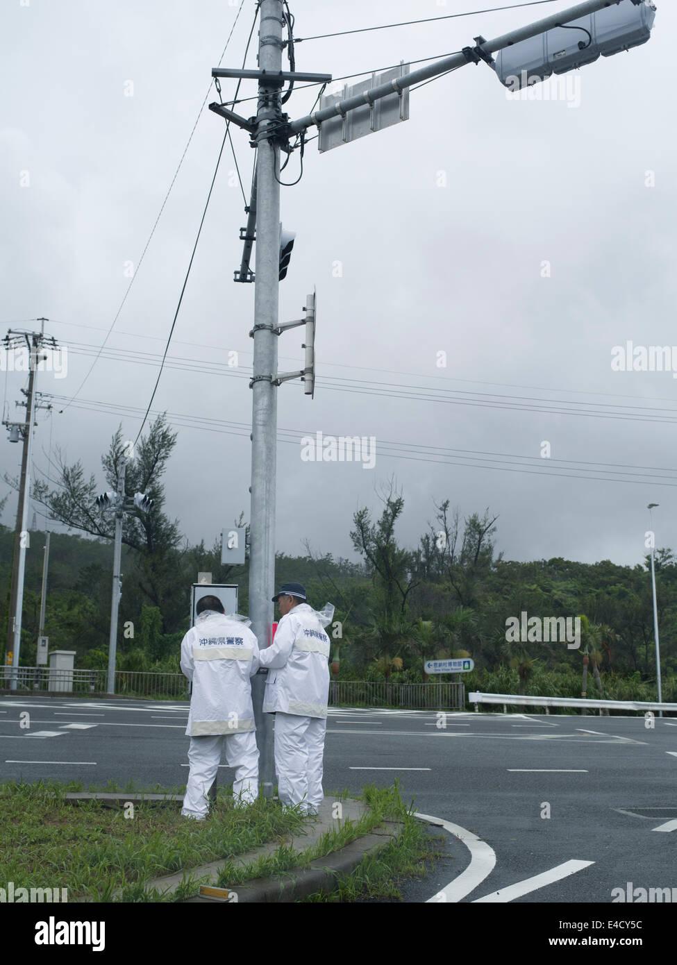 Typhoon Neoguri Okinawa, Japan. July 9th 2014, heavy rains and flooding continue as islands starts recovery. Traffic Stock Photo