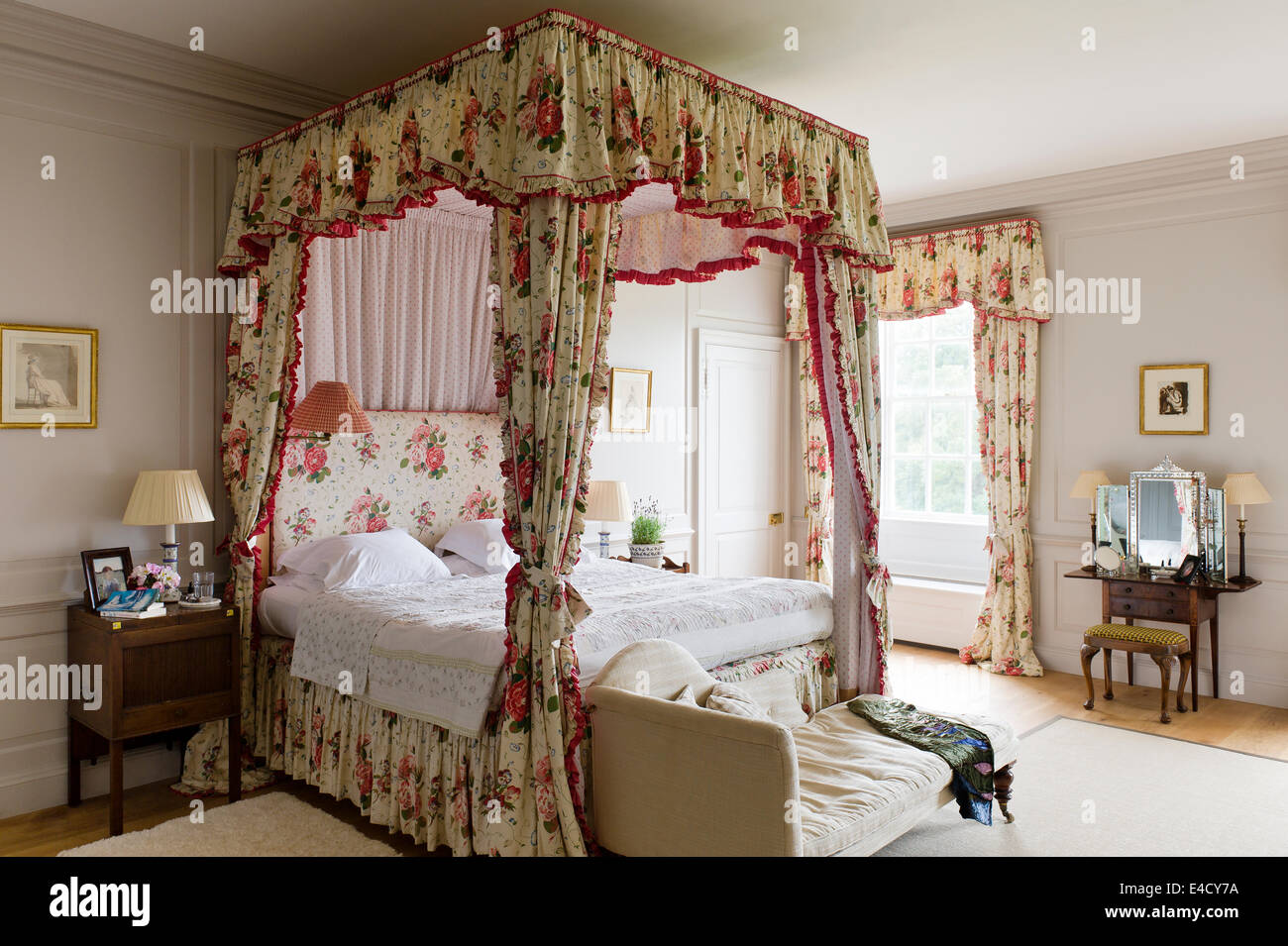 Fourposter Bed With Chintz Curtains In Bedroom With Chaise. A Romney  Drawing Hangs Above The Dressing Table