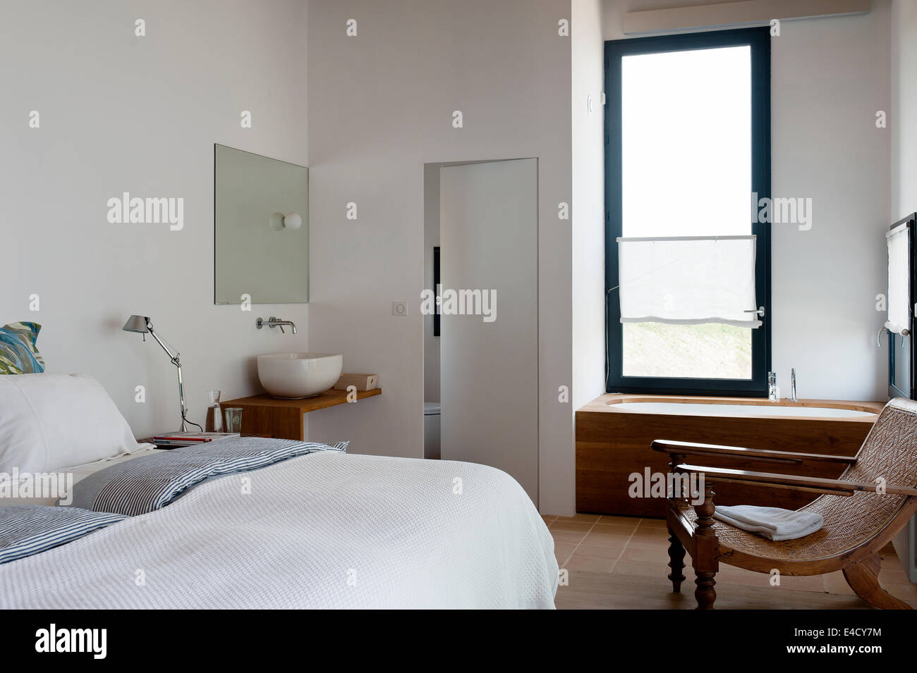Modern Bedroom With Bath And Wash Basin Stock Photo