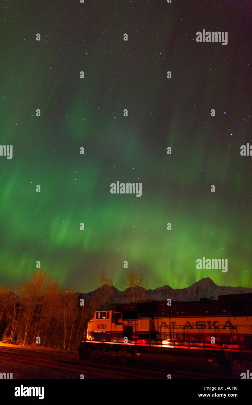 Aurora borealis over the Alaska Railroad, Seward, Alaska. - Stock Image