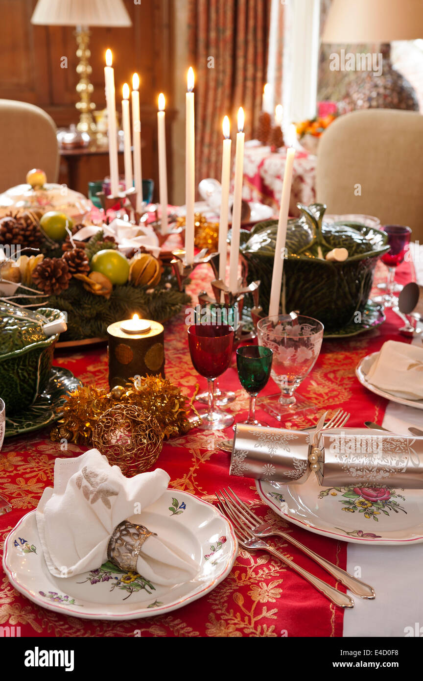 table laid for christmas dinner with candles and decorations the tableware is a mix of luneville old strasbourg pattern china a