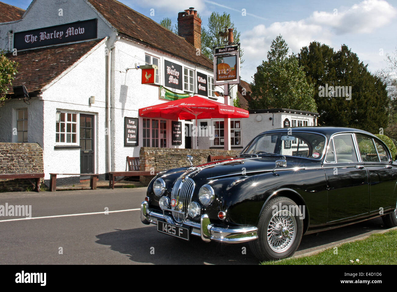 Classic Jaguar Mk 2 saloon parked at the Barley Mow Pub in Tilford, Surrey, Farnham, United Kingdom. - Stock Image