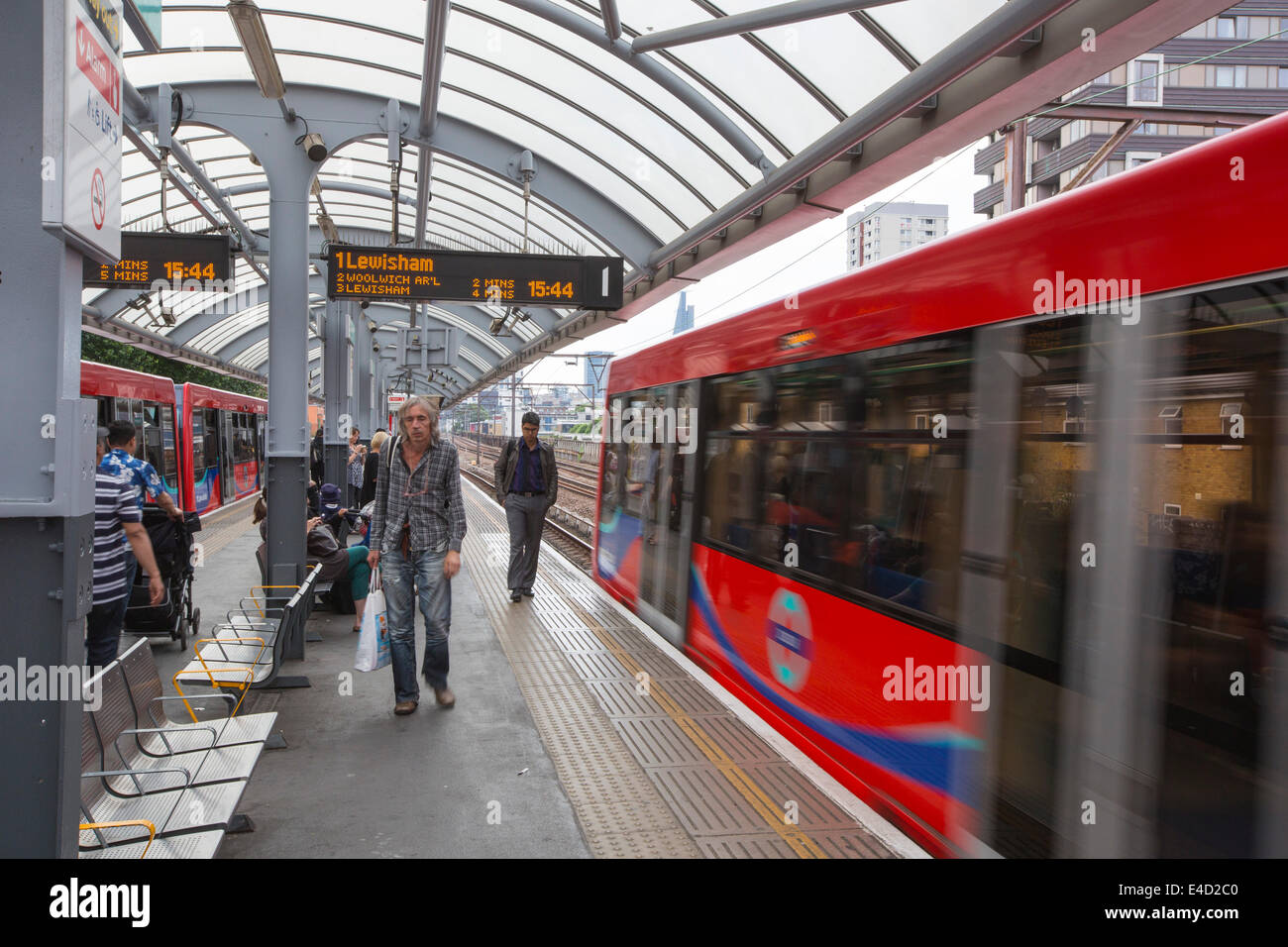 A Docklands Light Railway train (DLR) at a station near Canary wharf, London, UK. - Stock Image