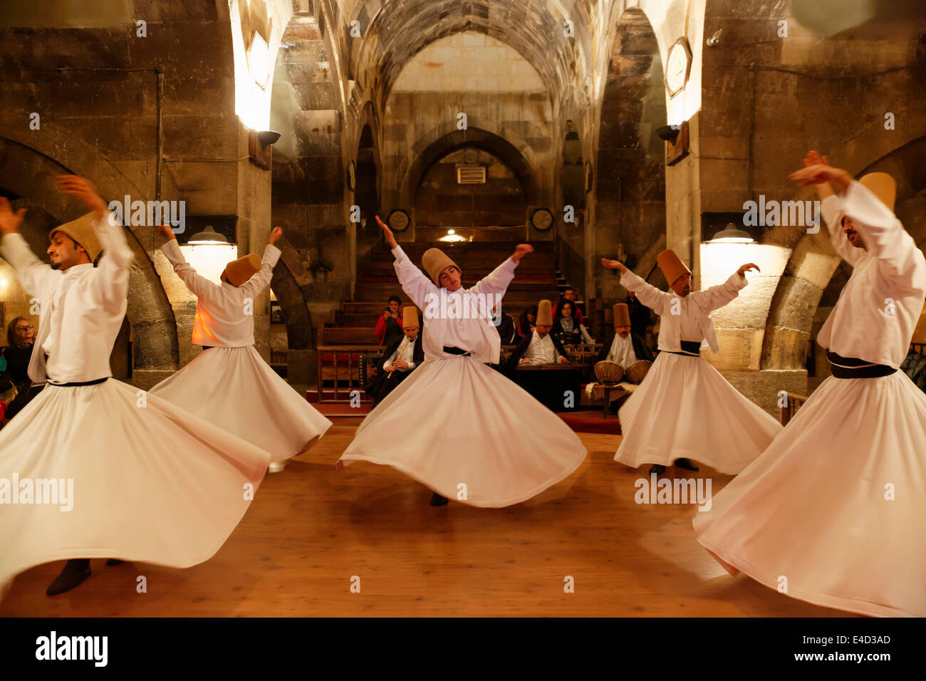 Whirling Dervishes of the Mevlevi Order, Sema ceremony, Saruhan Caravanserai, Sarıhan, near Avanos, Cappadocia - Stock Image
