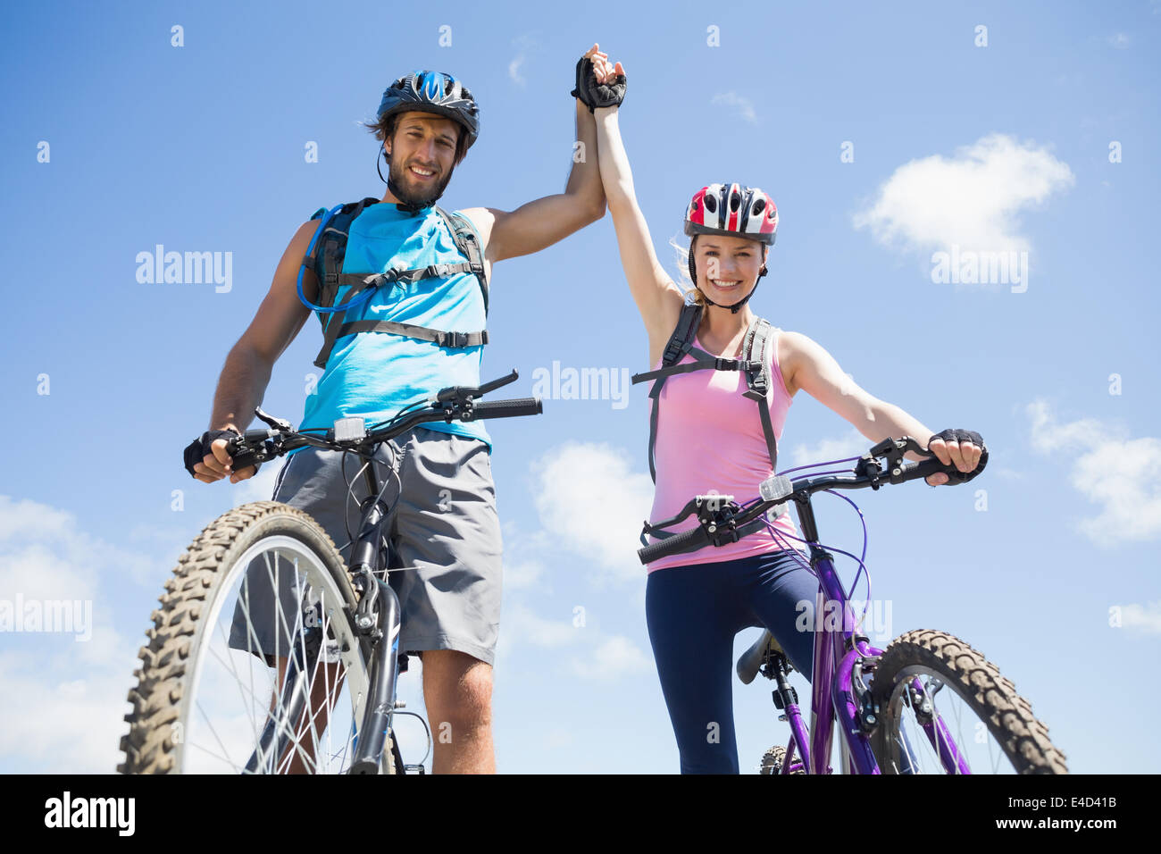 Fit cyclist couple happy to have reached the summit - Stock Image