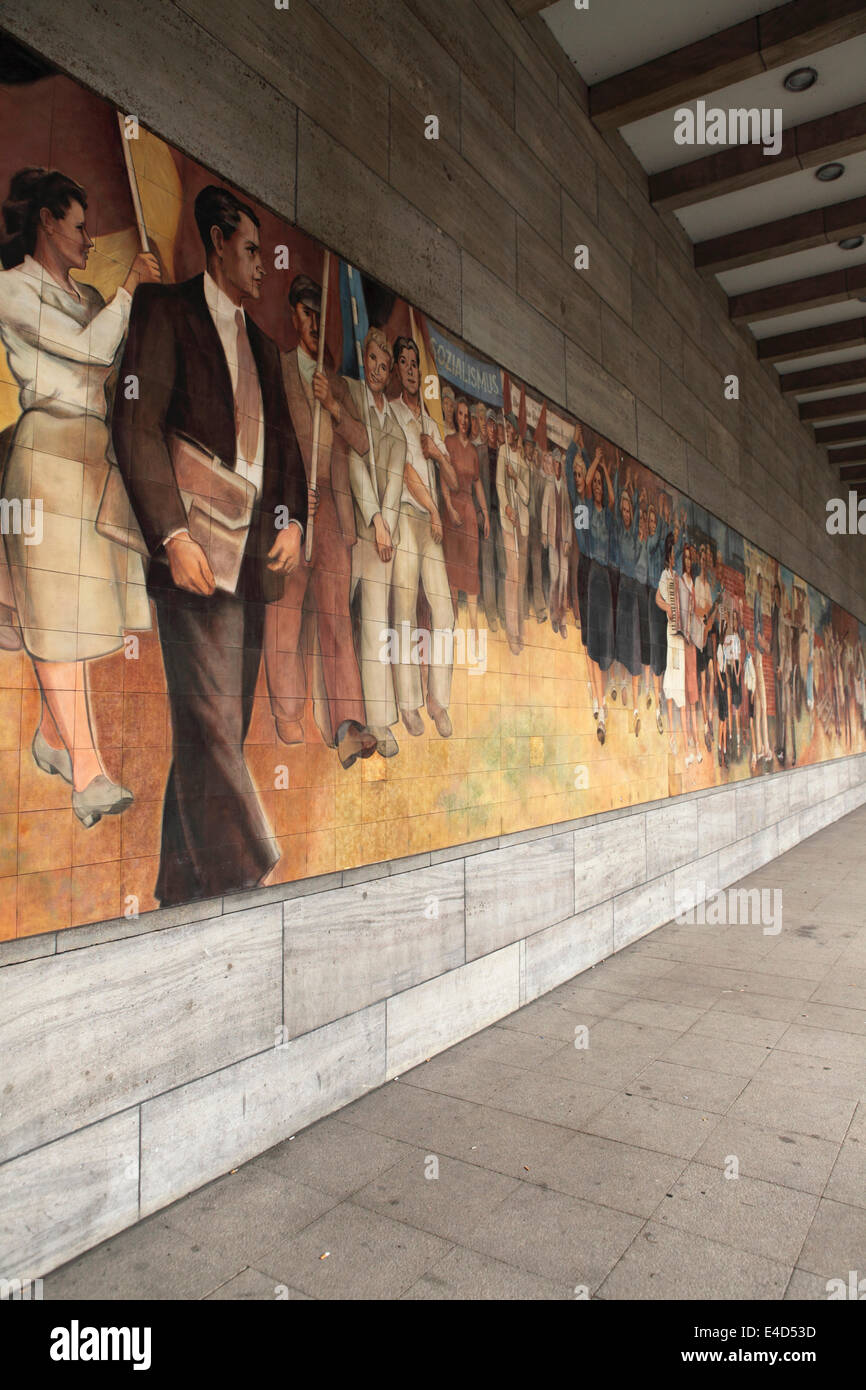Communist era mural at the former Soviet Military Administration headquarters in Berlin, Germany. - Stock Image