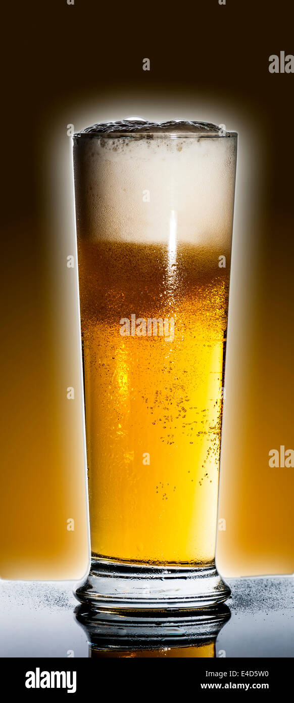 draught or draft beer on black reflex background with water drop on bottle - Stock Image