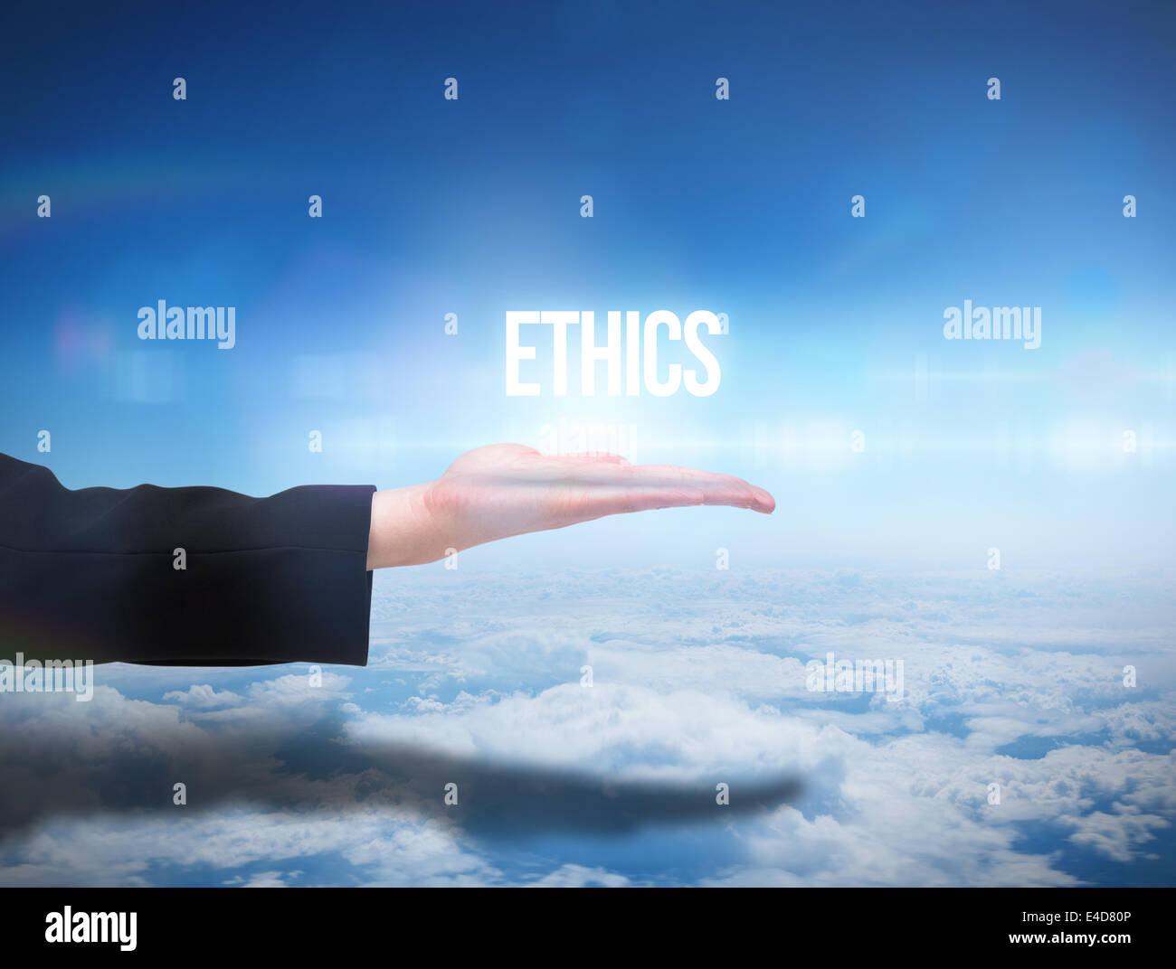 Businesswomans hand presenting the word ethics - Stock Image