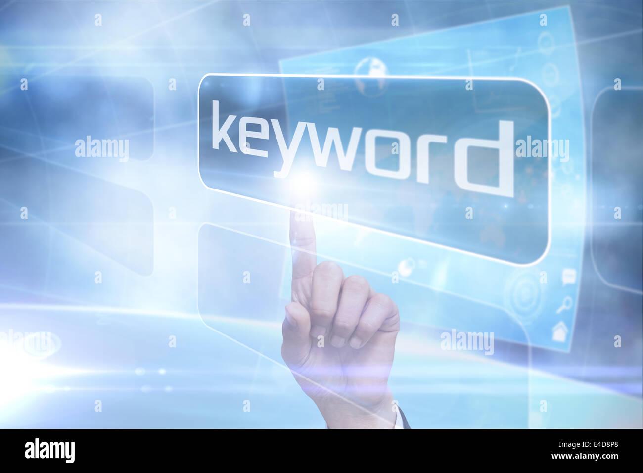 Businessman pointing to word keyword - Stock Image