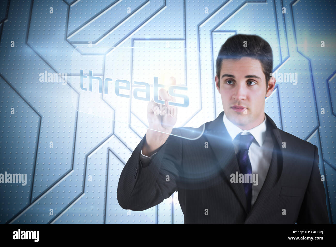 Businessman pointing to word threats - Stock Image