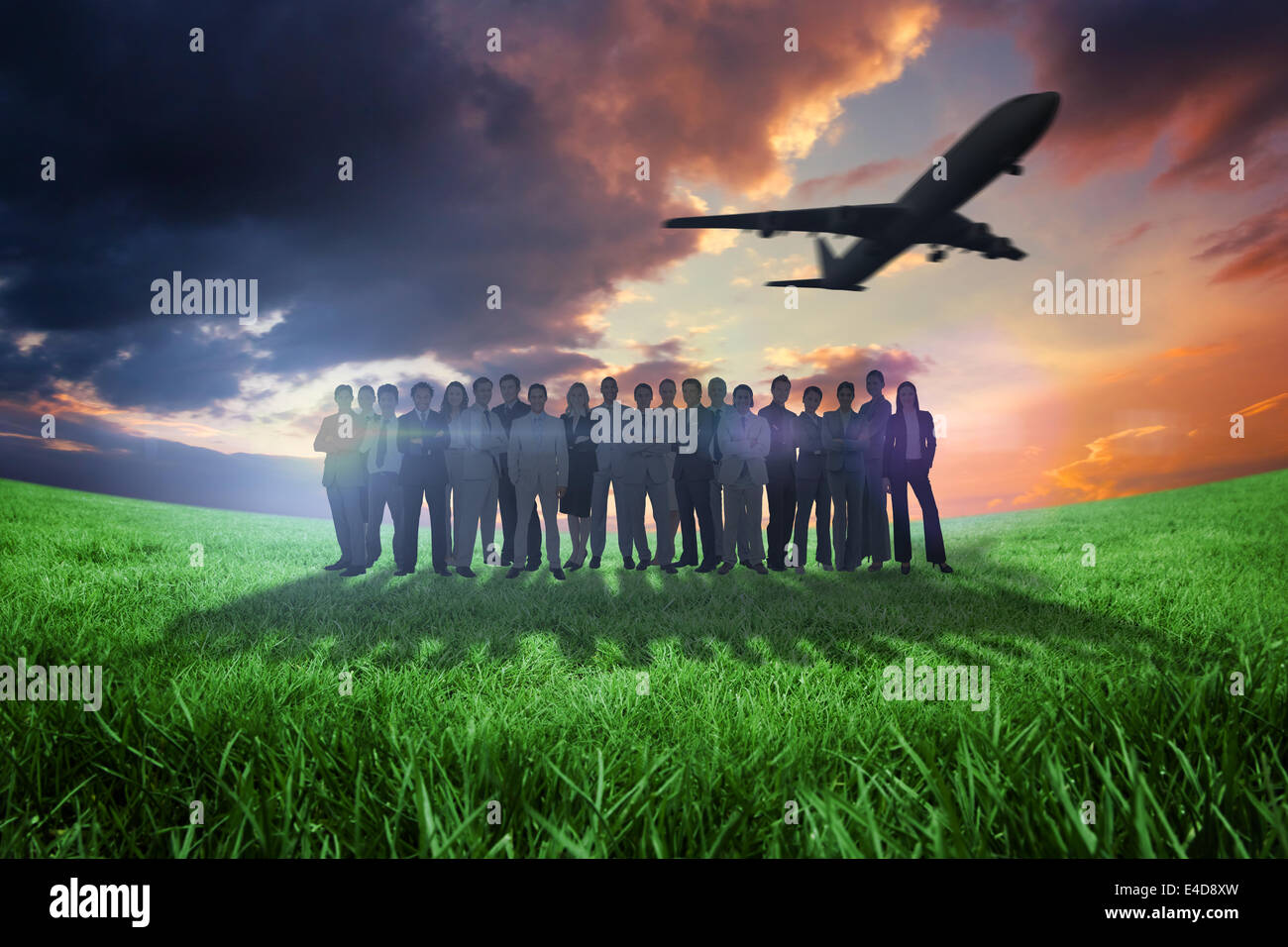 Composite image of business people standing up with airplane - Stock Image