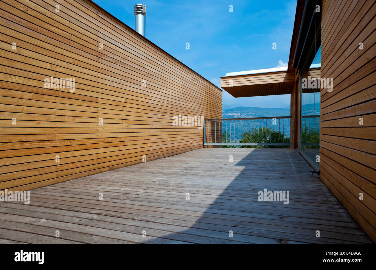totally wooden terrace of a new modern and sustainable building - Stock Image