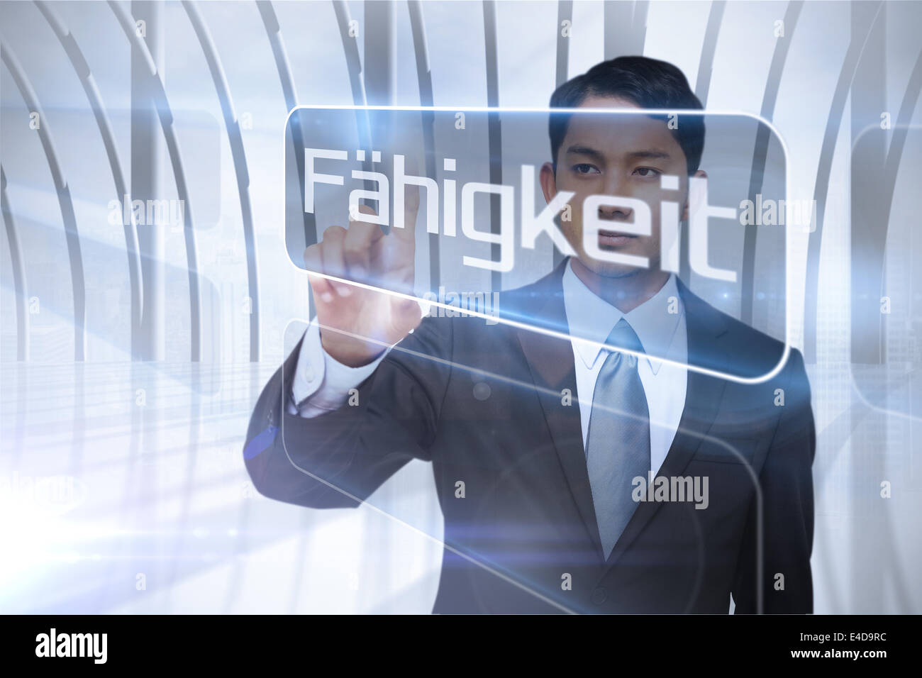 Businessman presenting the word ability in german Stock Photo