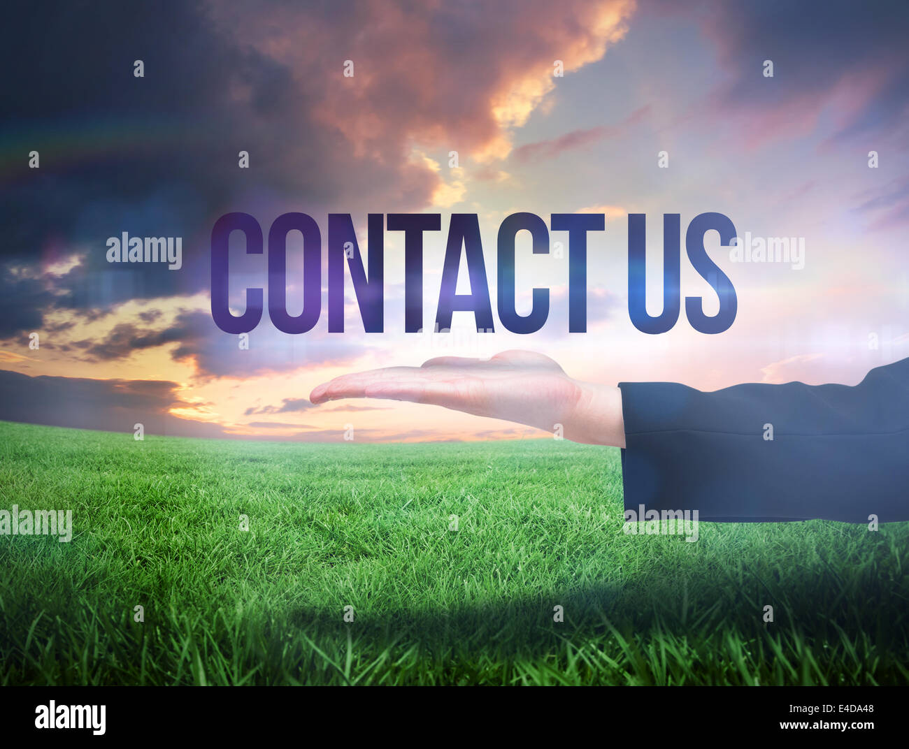Businesswomans hand presenting the words contact us - Stock Image