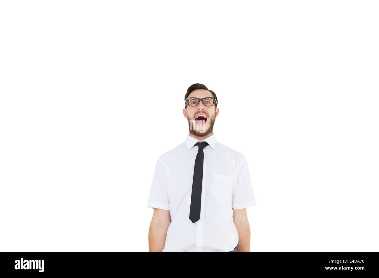 Geeky young businessman shouting loudly - Stock Image