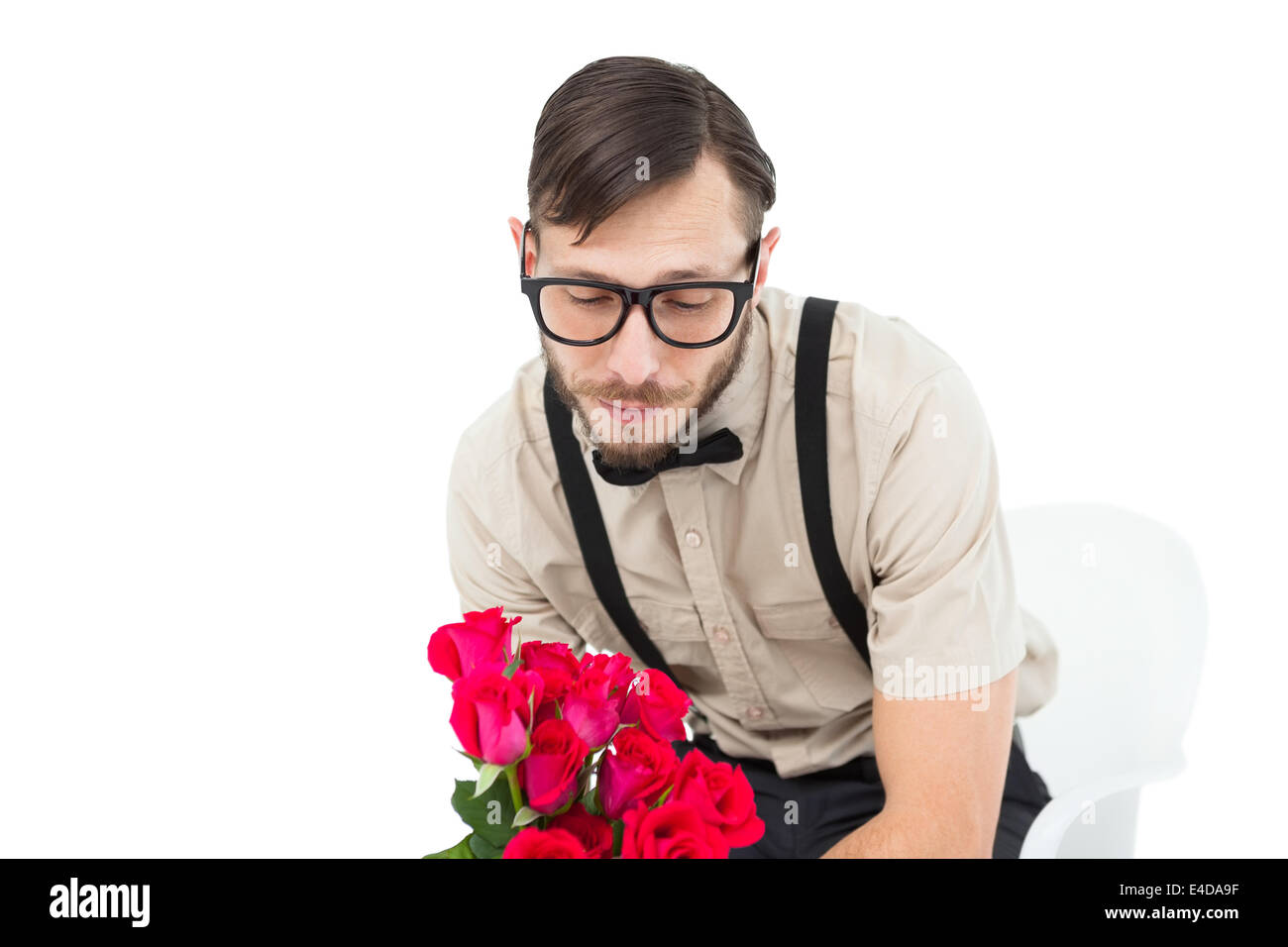 Geeky heartbroken hipster holding roses - Stock Image