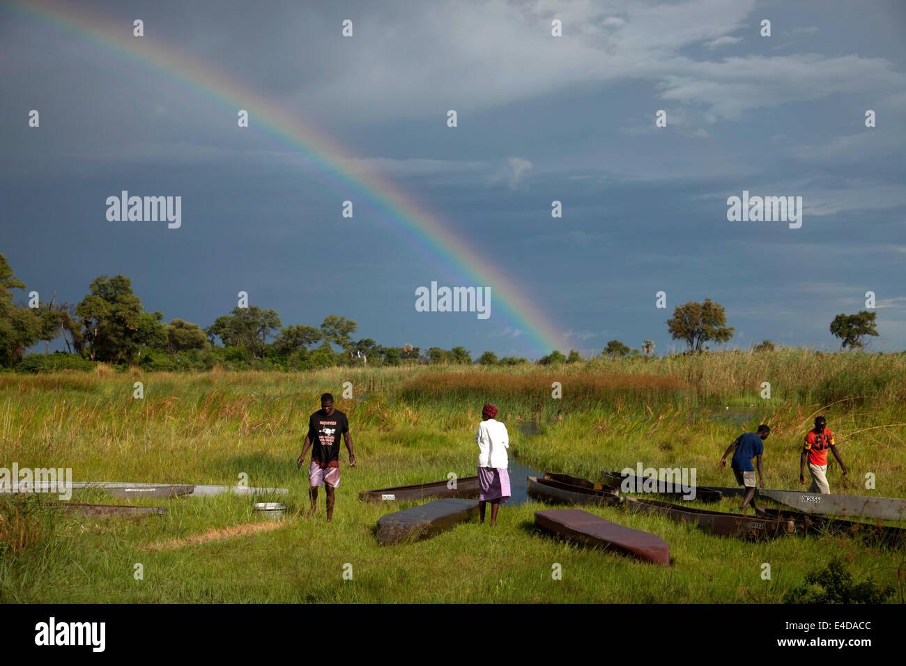 traditional mokoro boats and rainbow in the Okavango Delta, Botswana, Africa - Stock Image