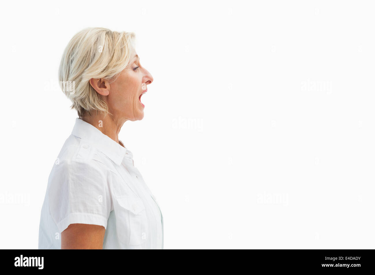 Happy mature woman talking loudly - Stock Image