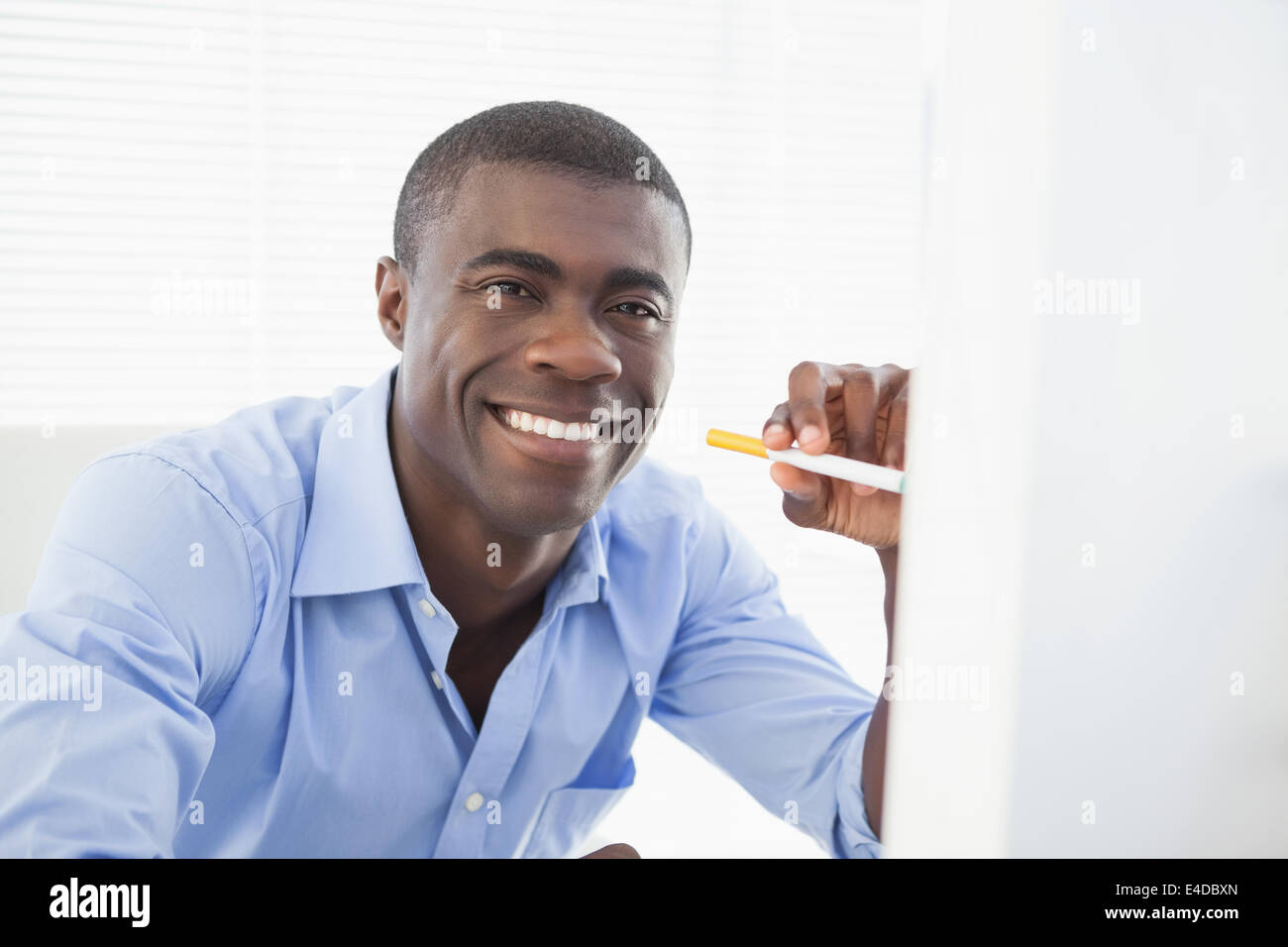 Happy businessman with electronic cigarette - Stock Image