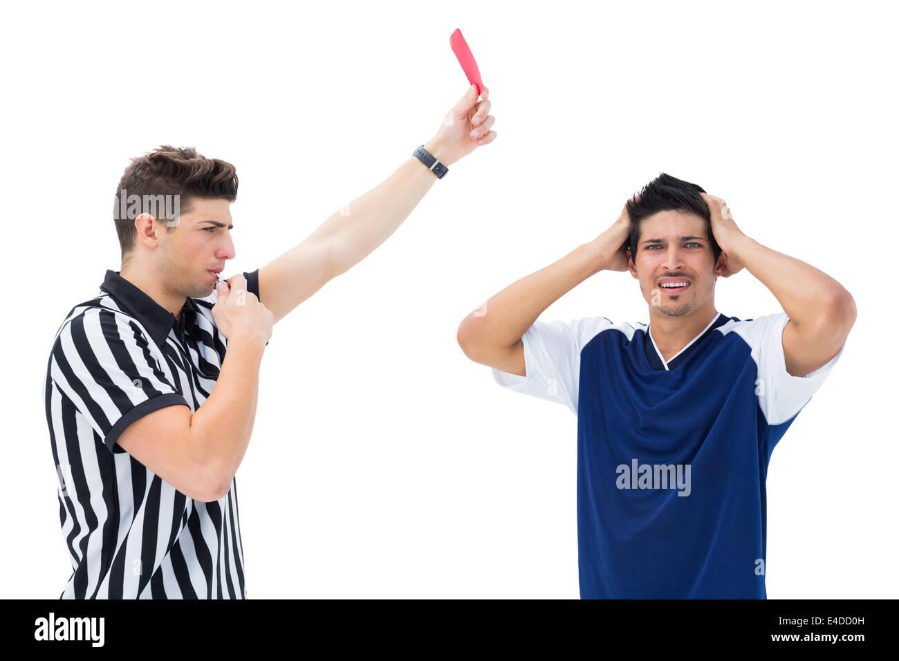 Referee sending off football player - Stock Image