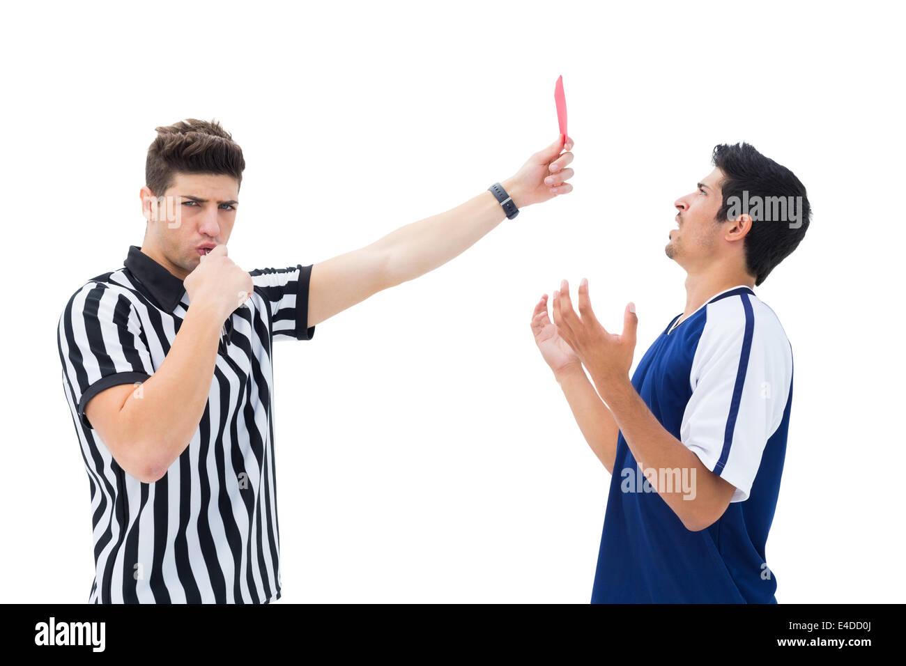 Referee sending off football player Stock Photo