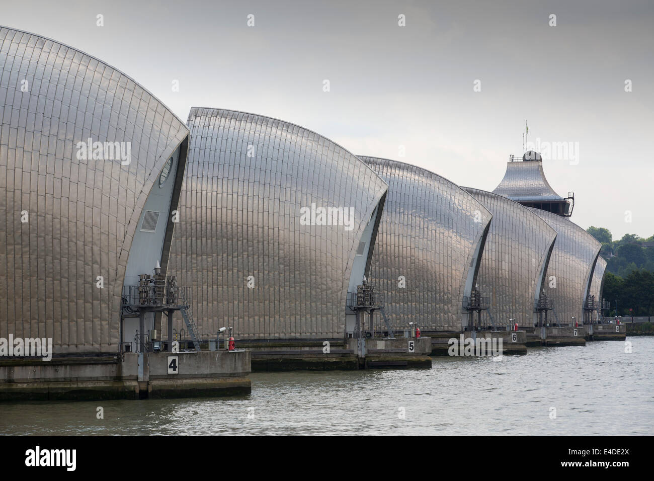 The Thames barrier on the River Thames in London. It was constructed to protect the capital city from storm surge - Stock Image