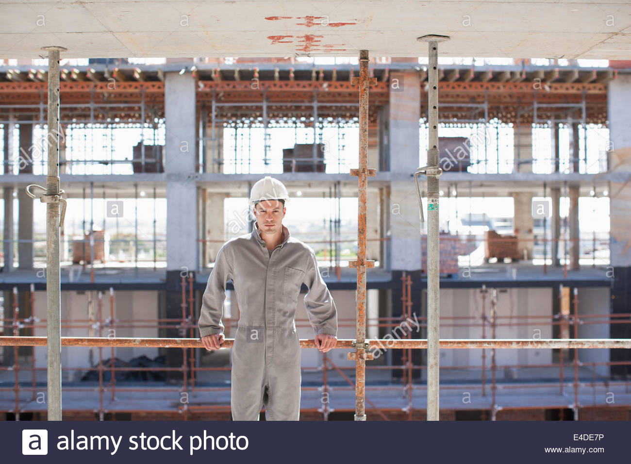 Construction worker on construction site - Stock Image