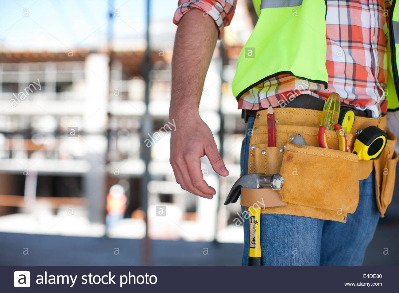 Close up of construction workerÂ's tool belt on construction site - Stock Image