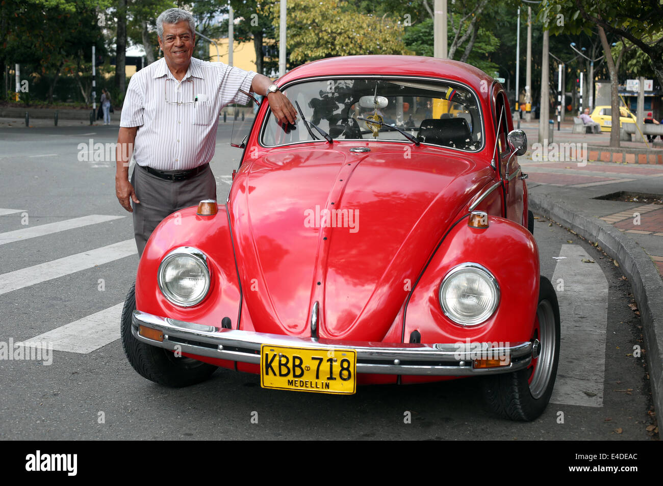 Man with classic volkswagen beetle in Medellin, Medellín, Colombia ...