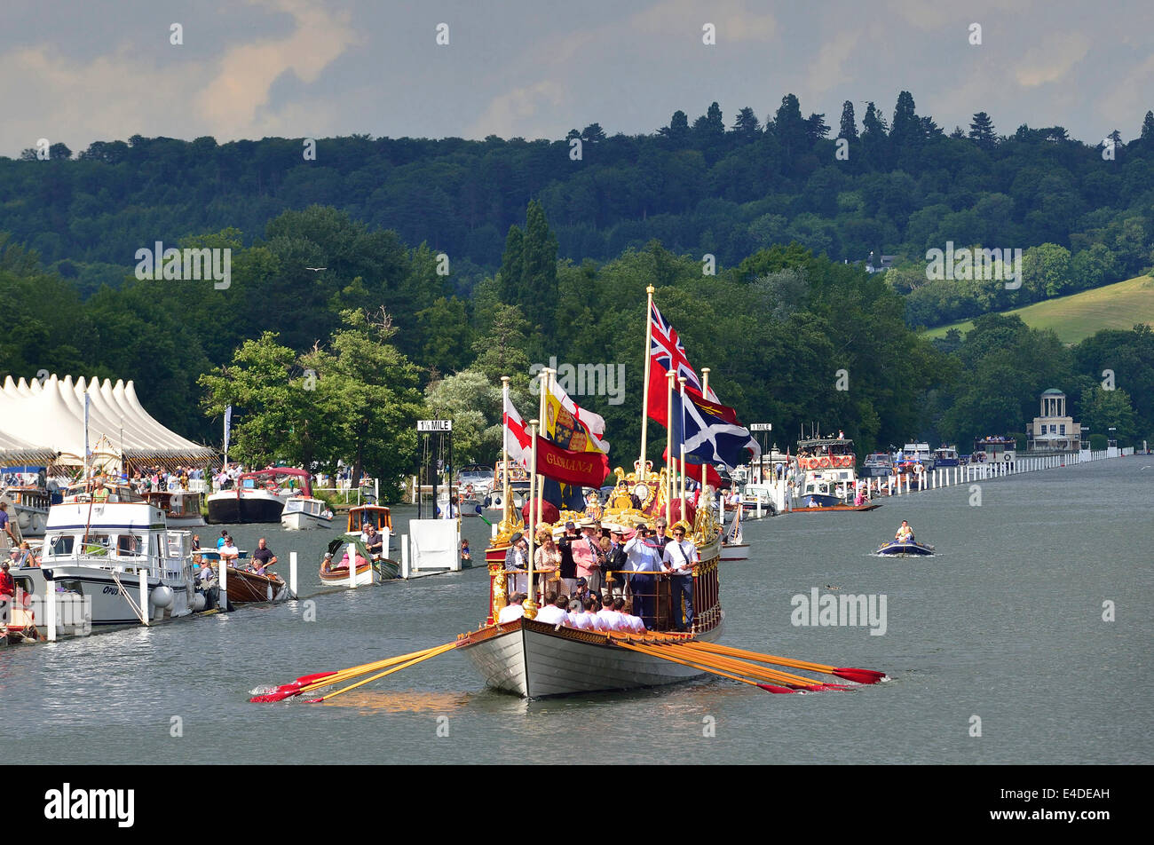 Gloriana, the rowing barge built for the Queen's Diamond Jubilee, n a row past during175th anniversary of Henley - Stock Image