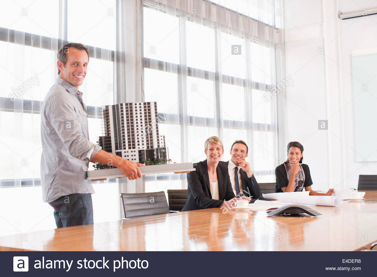 Business people with model building - Stock Image