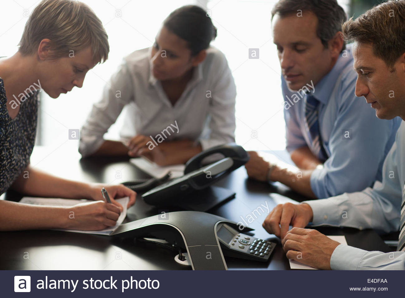 Business people talking on conference call - Stock Image