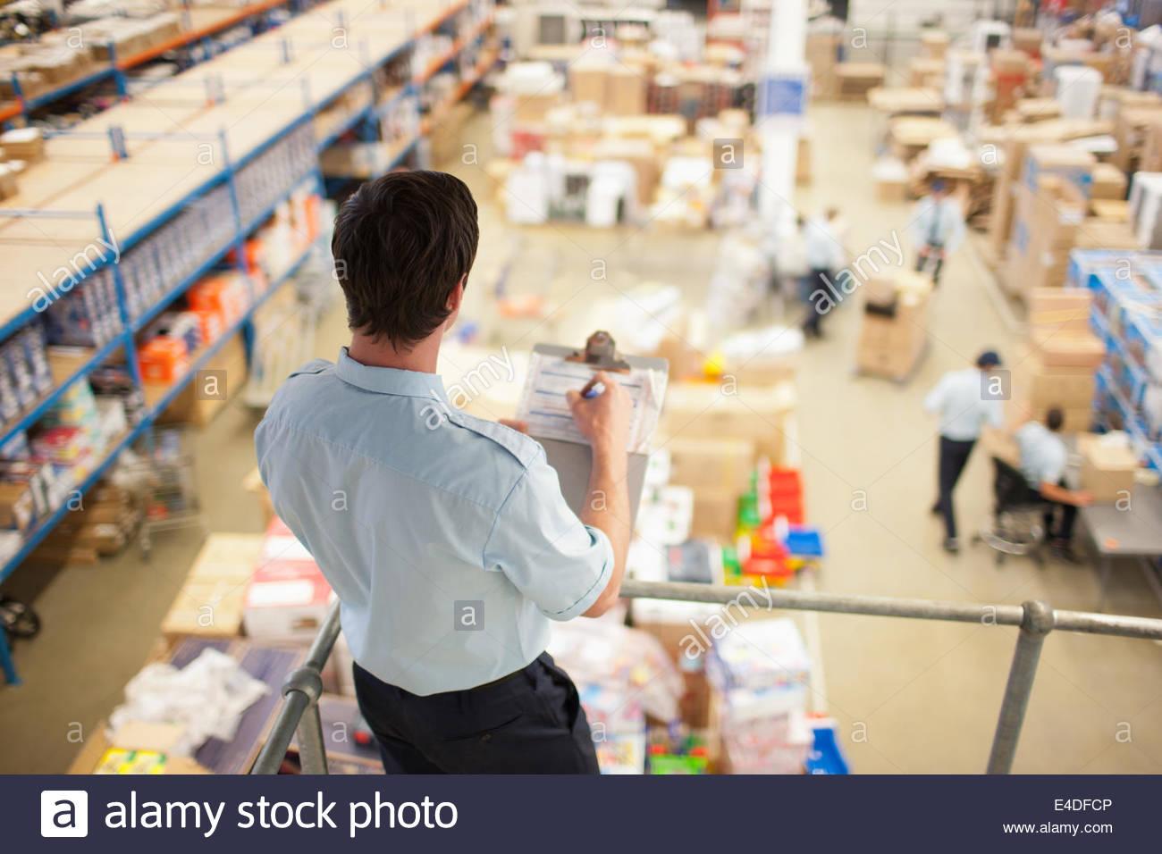 Supervisor  monitoring shipping work - Stock Image