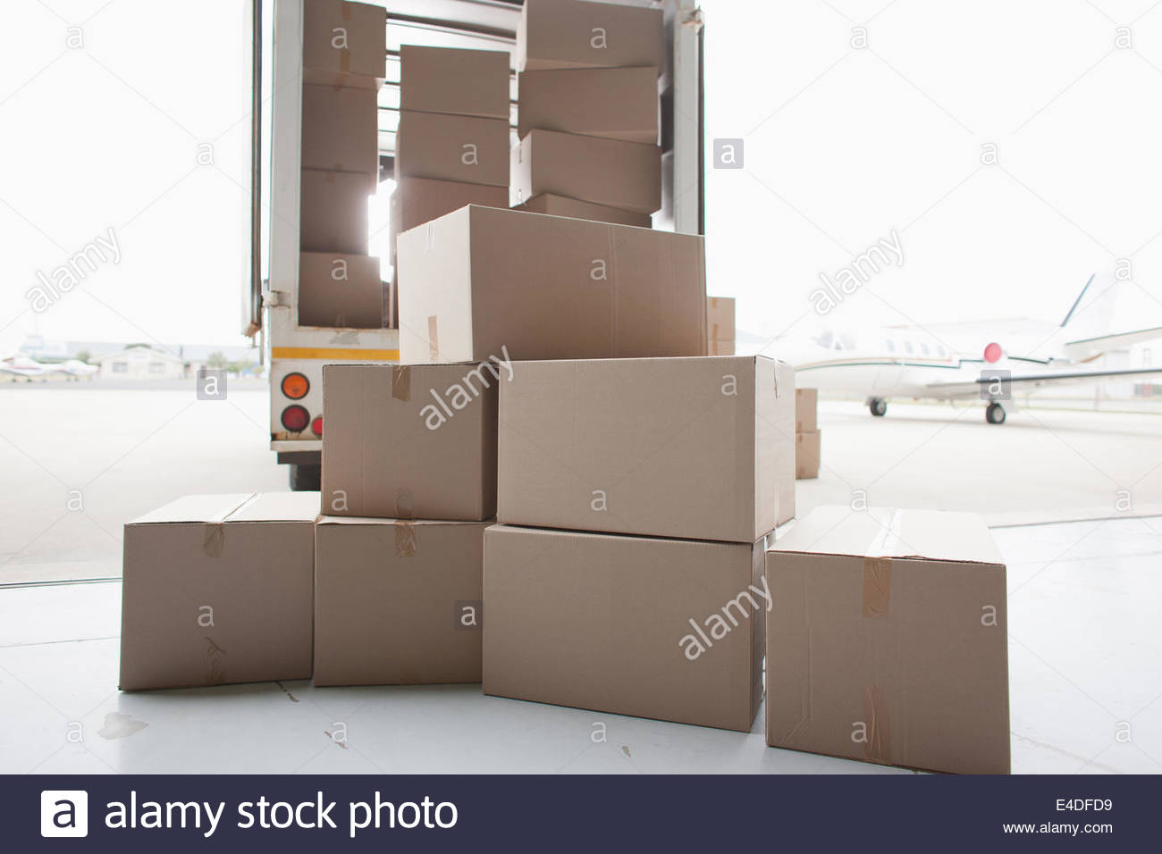 Boxes waiting to be loaded onto truck - Stock Image