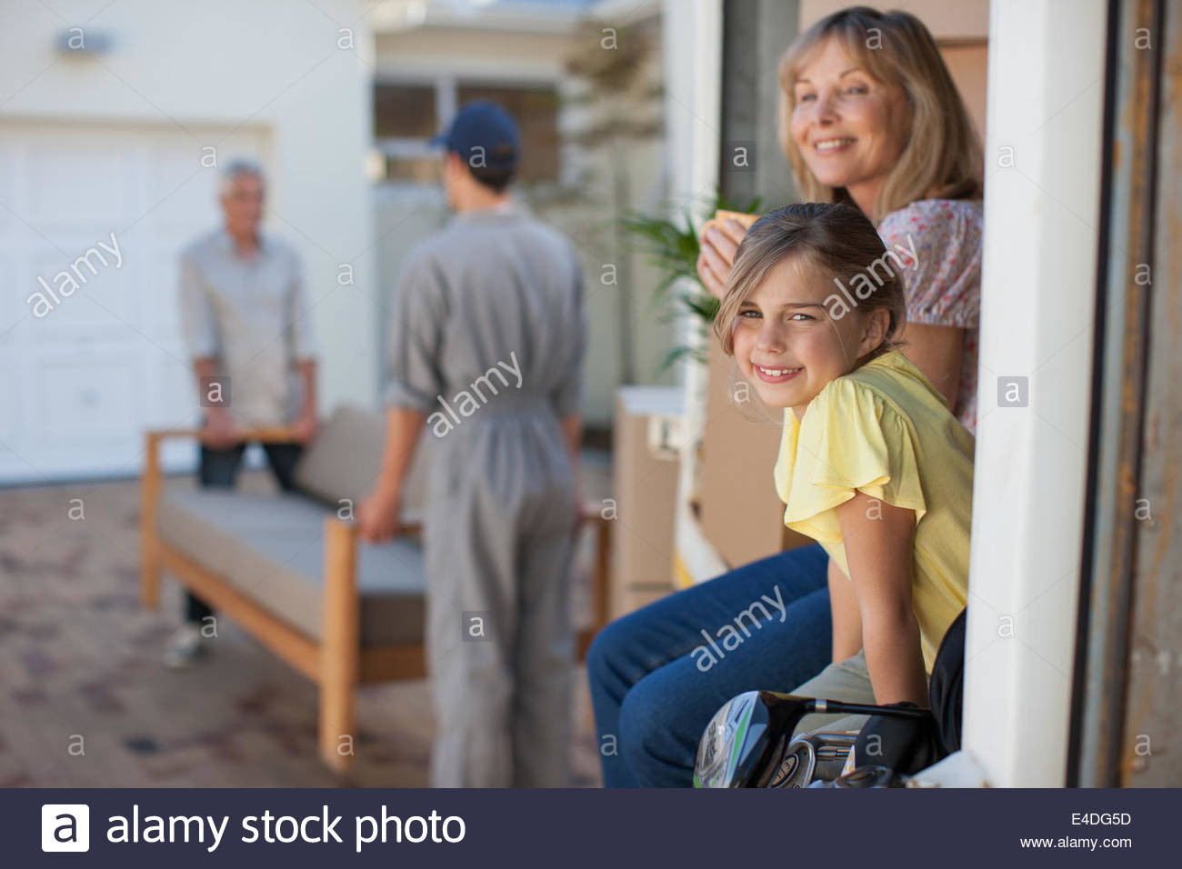 Family moving into new home - Stock Image