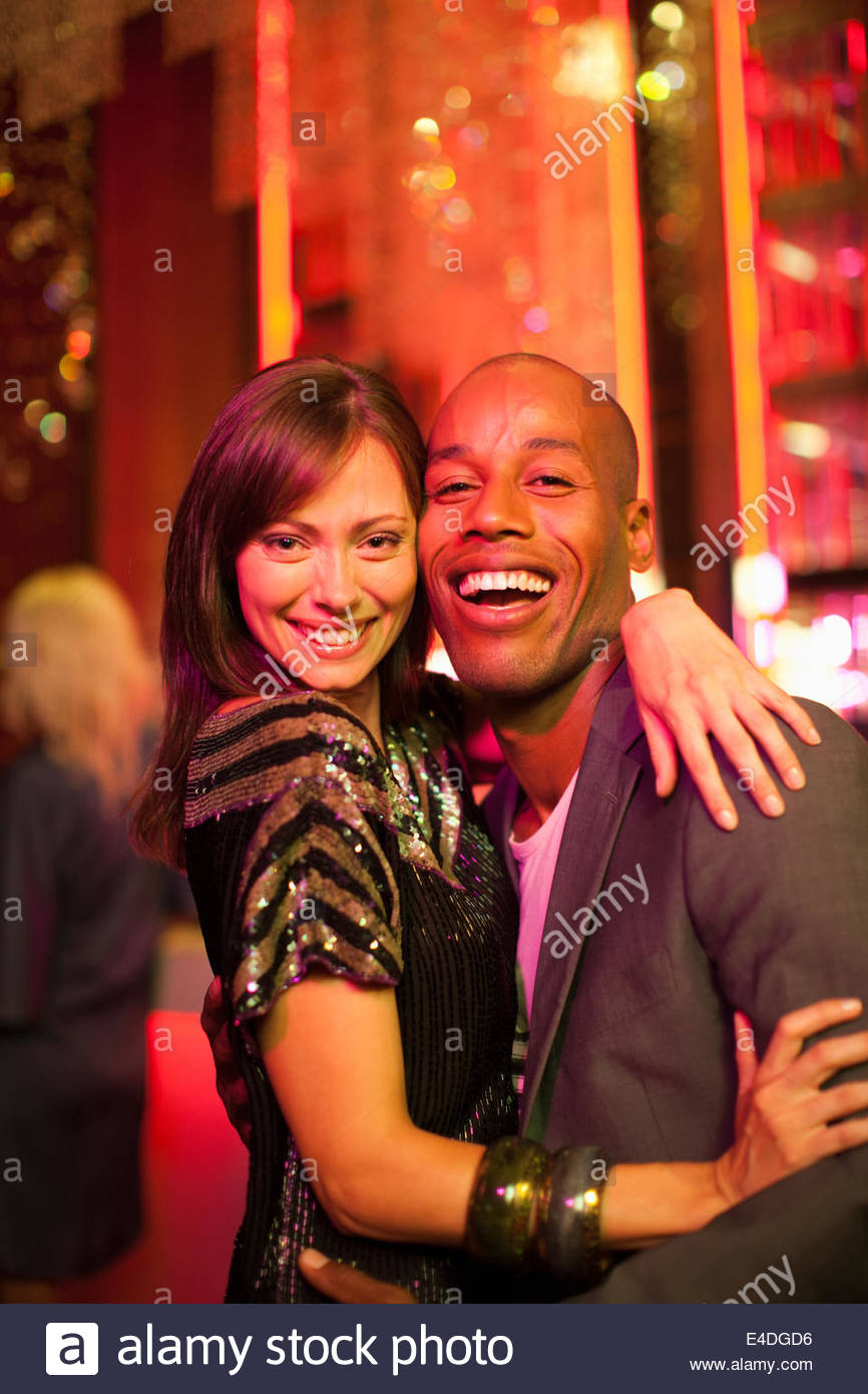 Couple hugging in nightclub Stock Photo