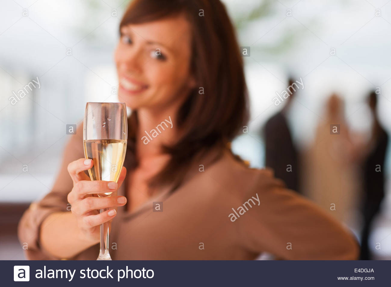 Woman drinking champagne - Stock Image